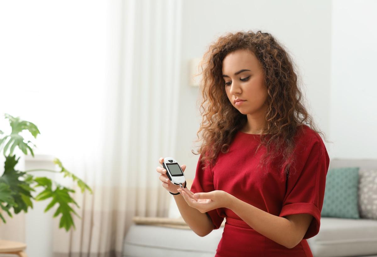 Woman doing diabetes test