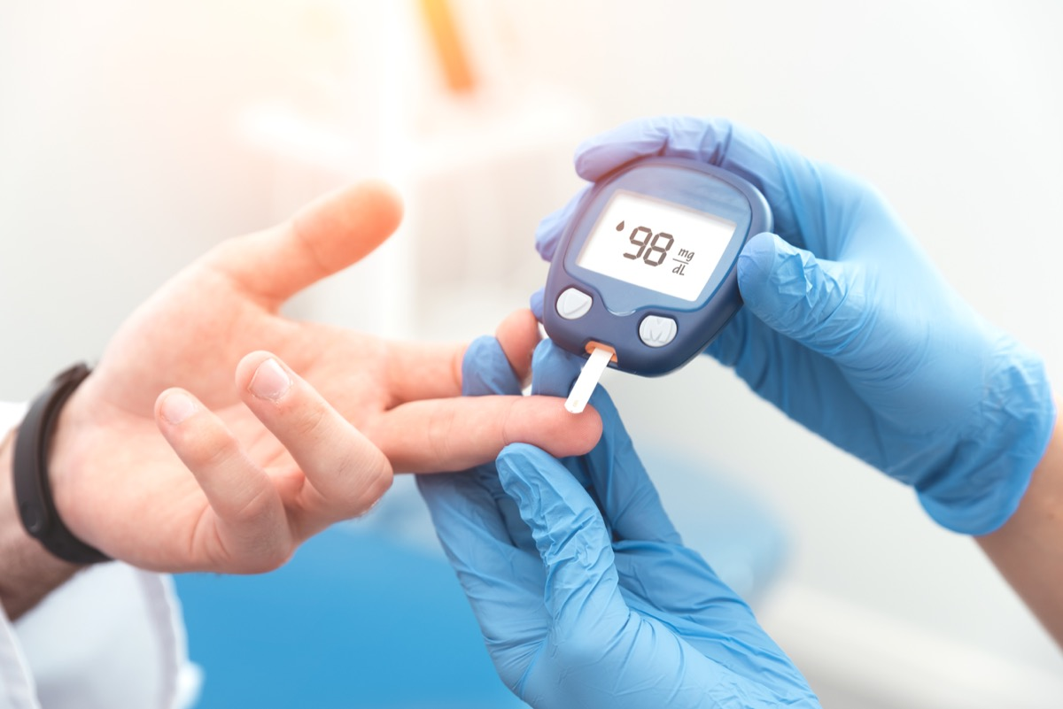 Doctor checking patient with diabetes