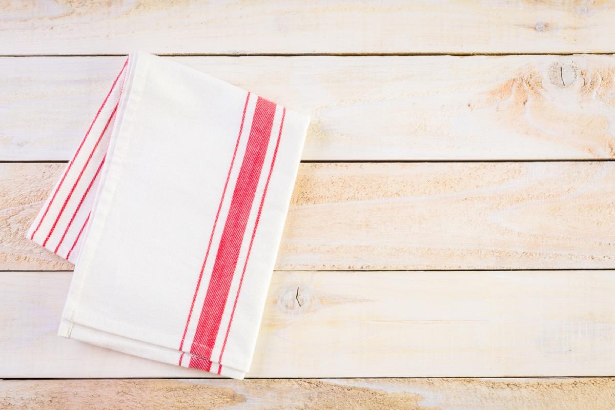 dish towel folded on wood background