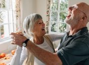 senior couple dancing in home