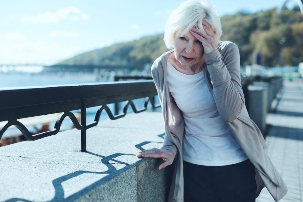 Elderly woman dizzy delirium