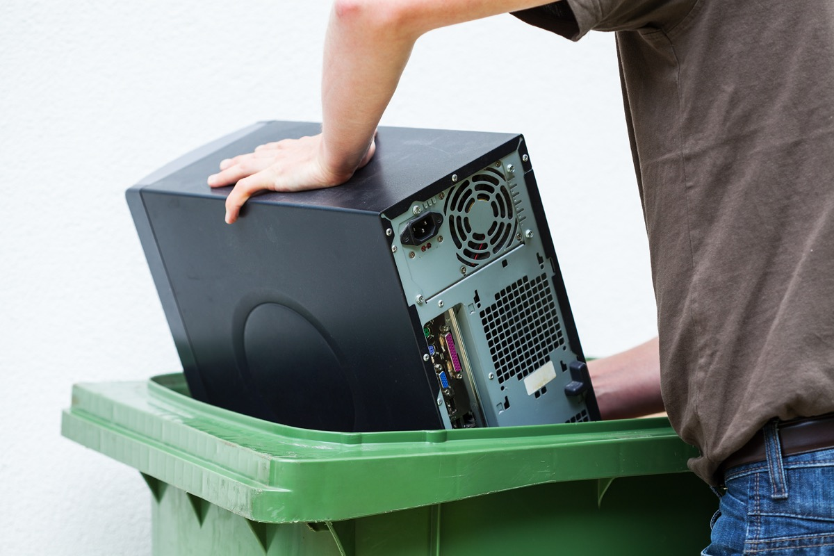 Man throwing out electronic