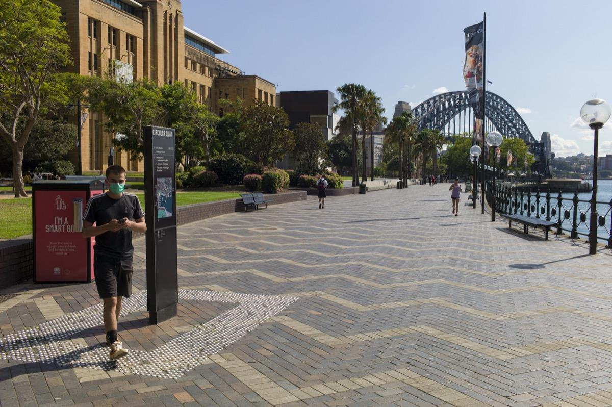 Empty Circular Quay with Sydney Harbor Bridge during coronavirus outbreak