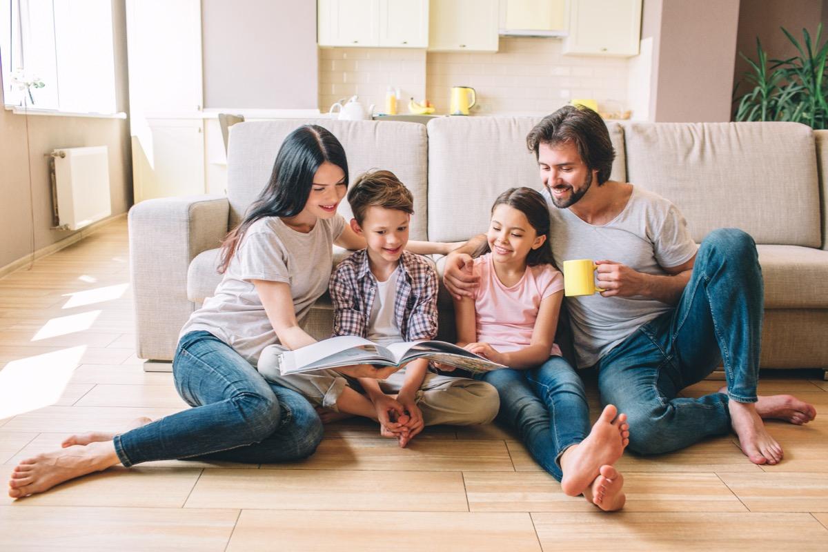 Family sitting on floor reading