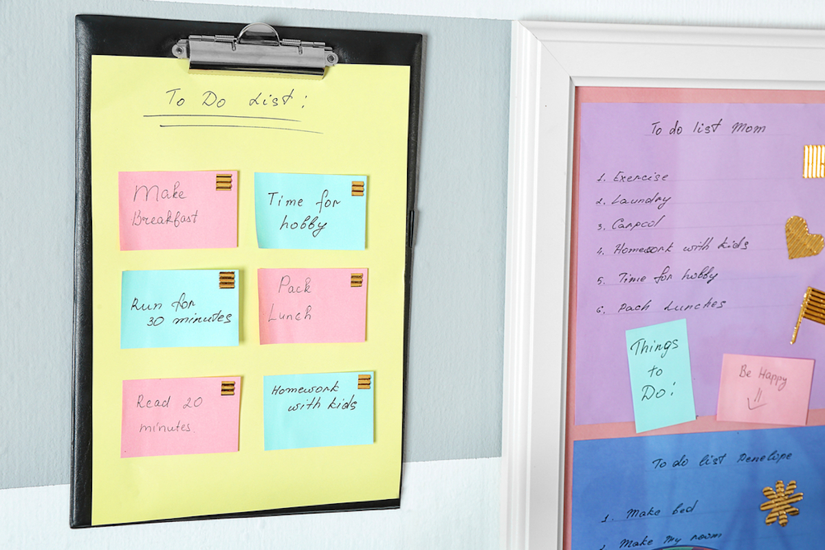family to-do list on wall, color coded