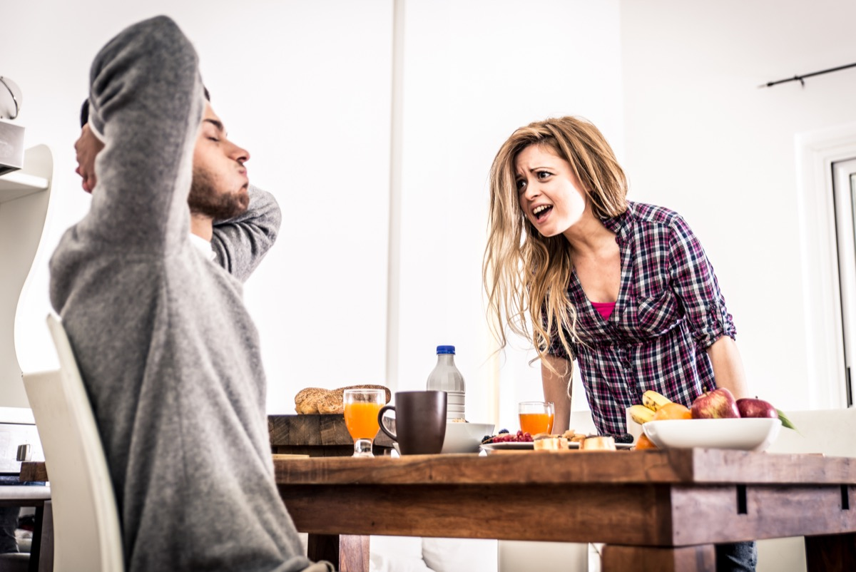 Couple fighting at table