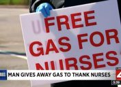 man holding free gas for nurses sign
