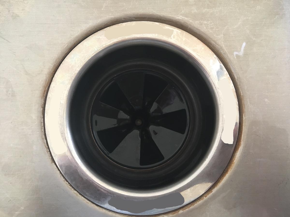garbage disposal in steel sink