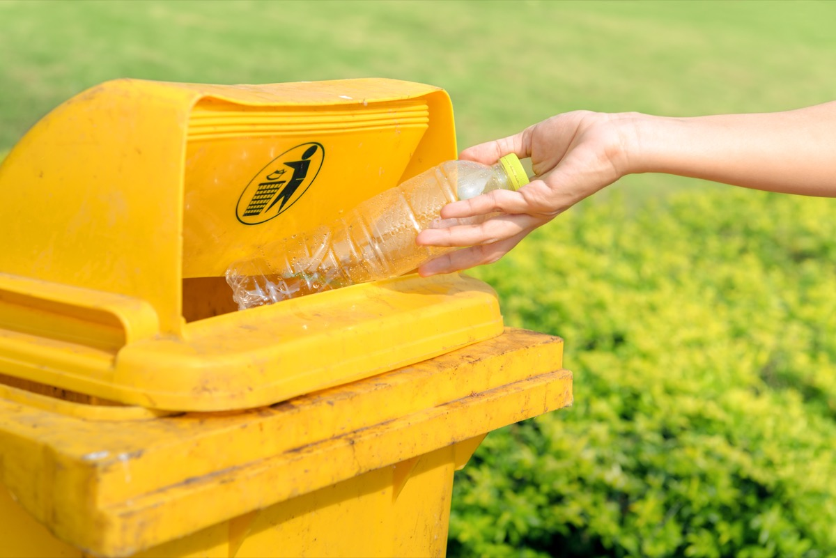 Throwing water bottle in garbage