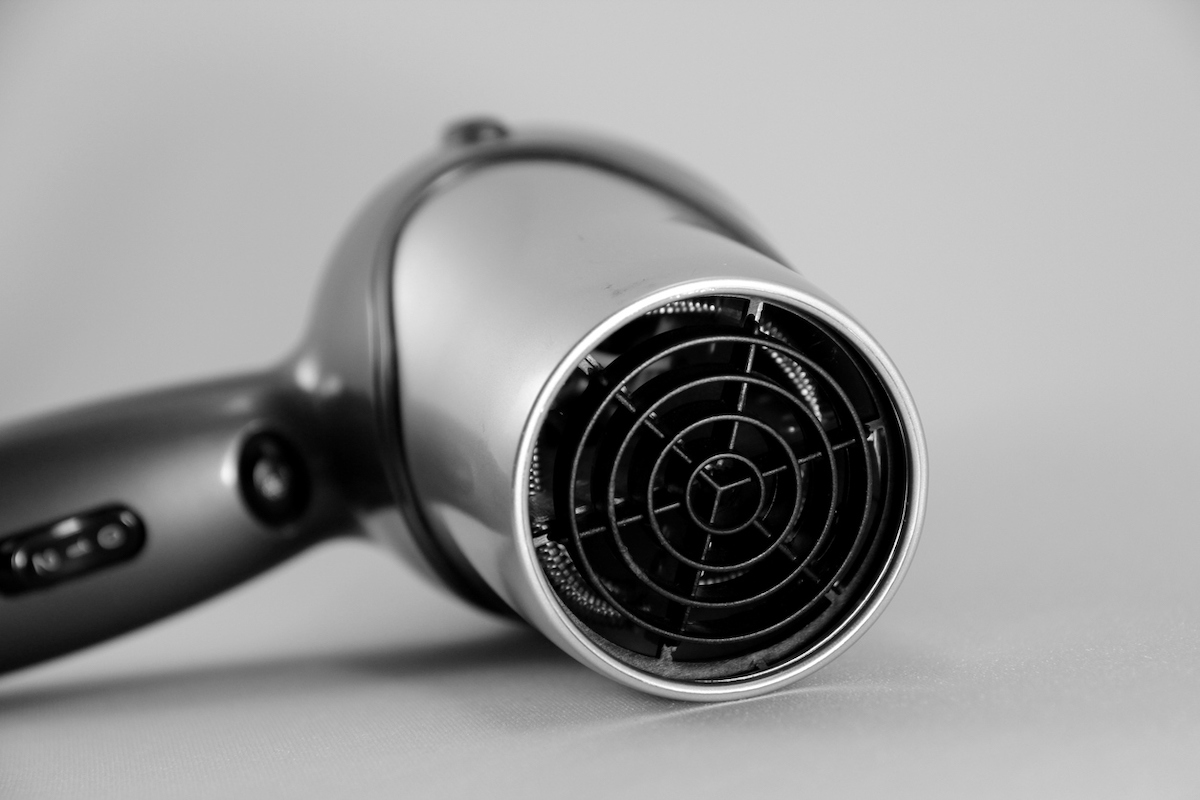 hair dryer on gray background