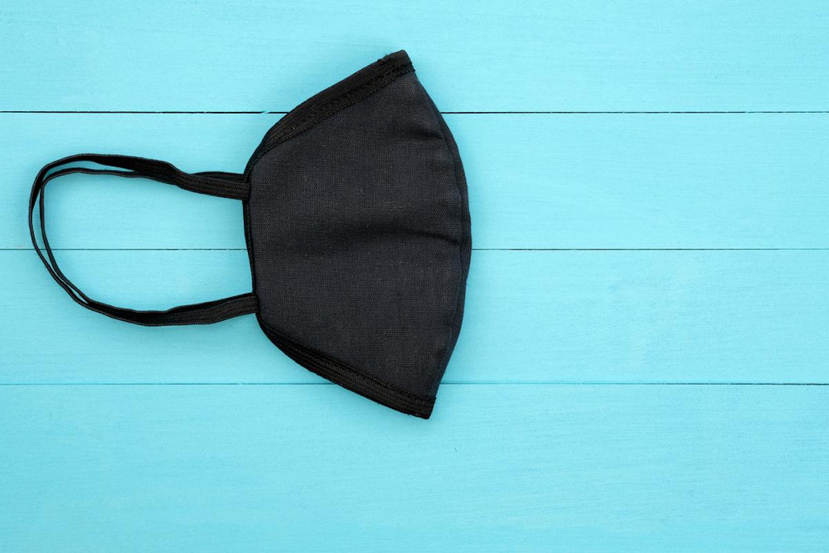 face mask folded in half on black background