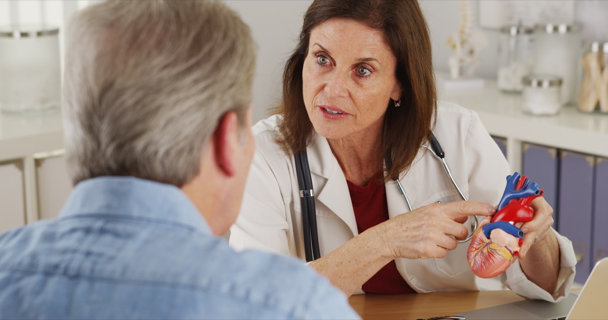 Doctor discussing patient's heart with him about heart condition