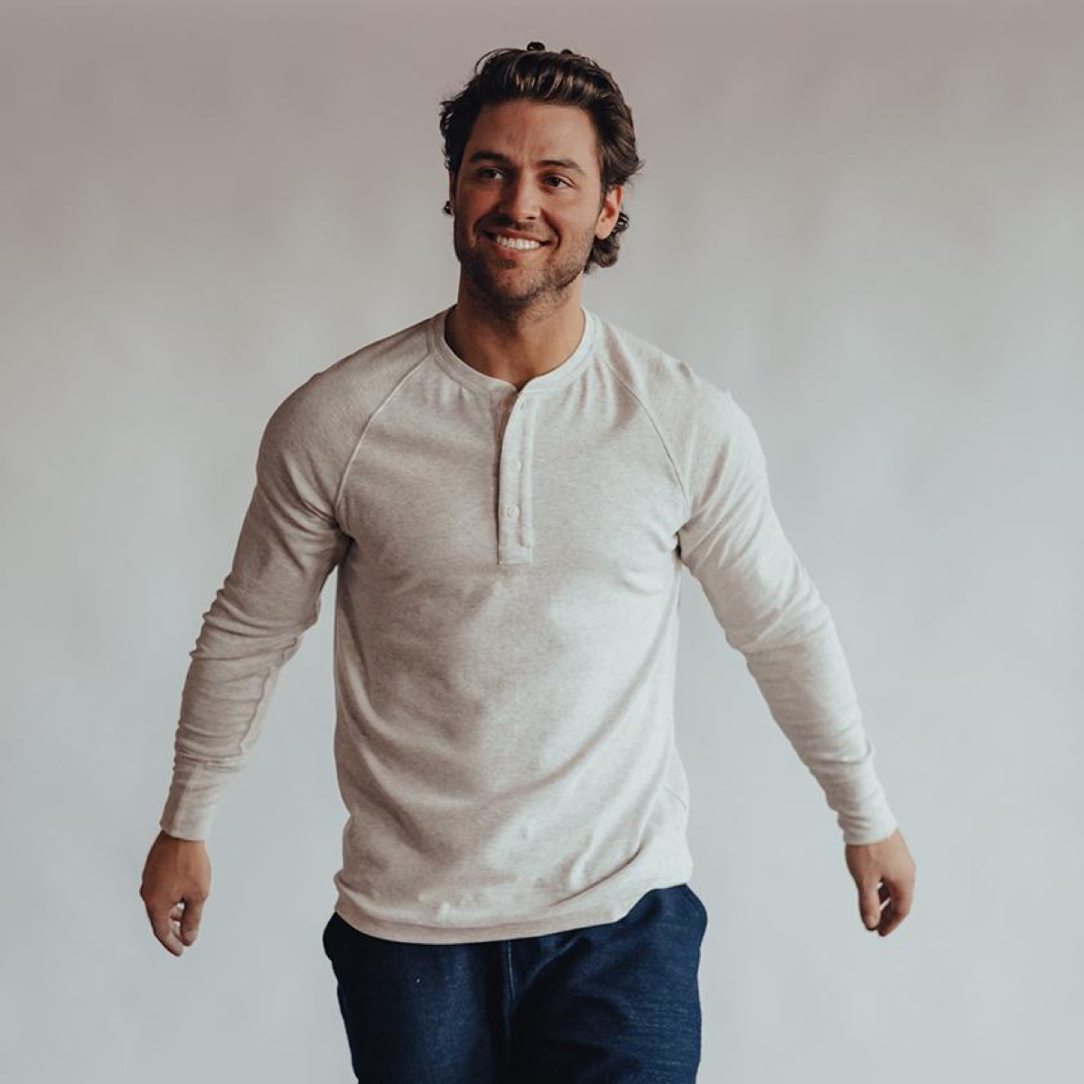 young man in cream colored henley