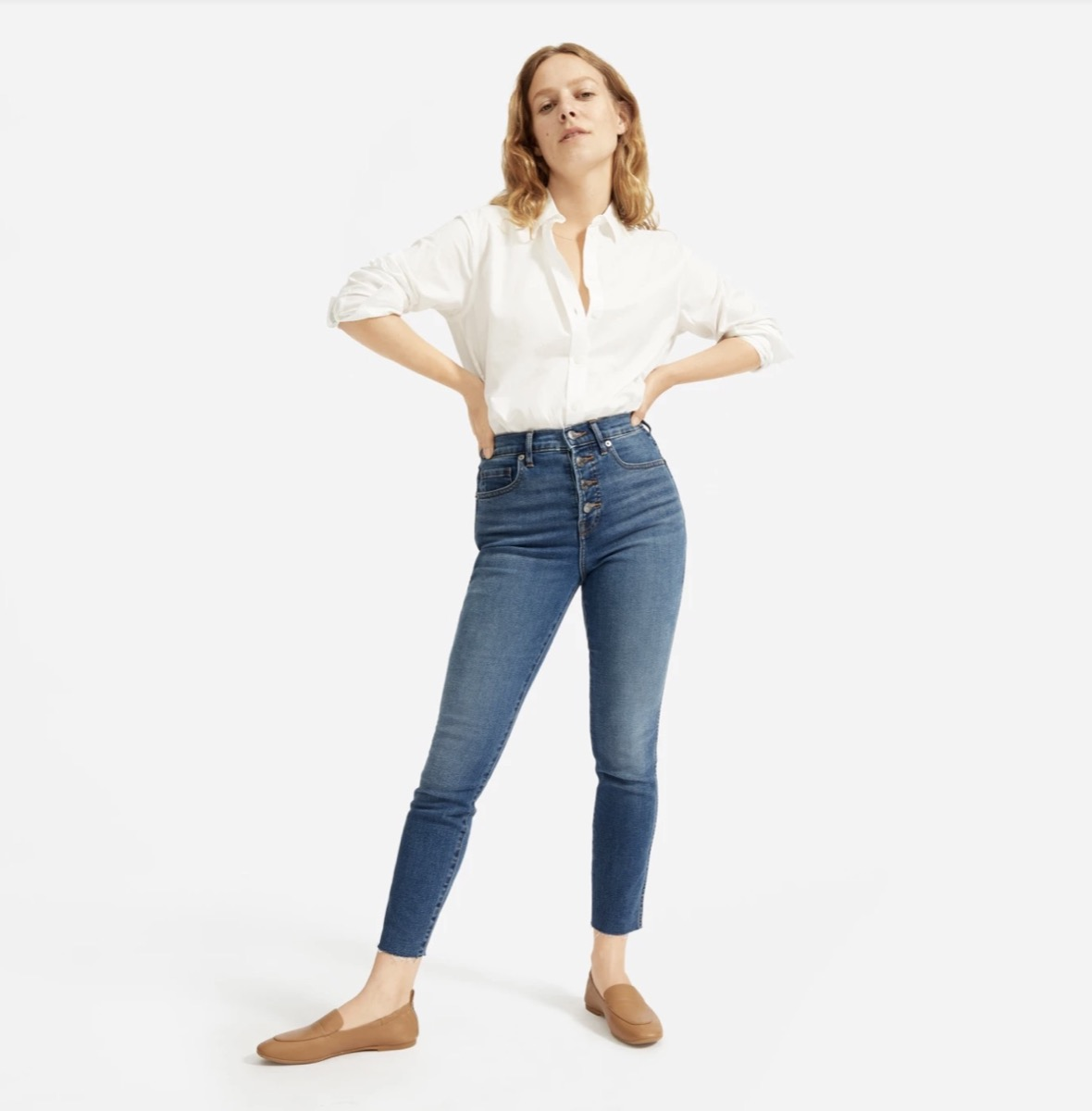 woman in high rise blue jeans