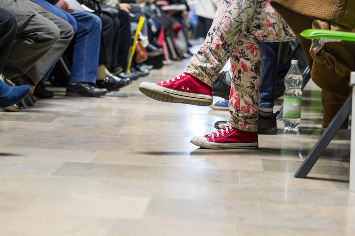 feet of people in waiting room
