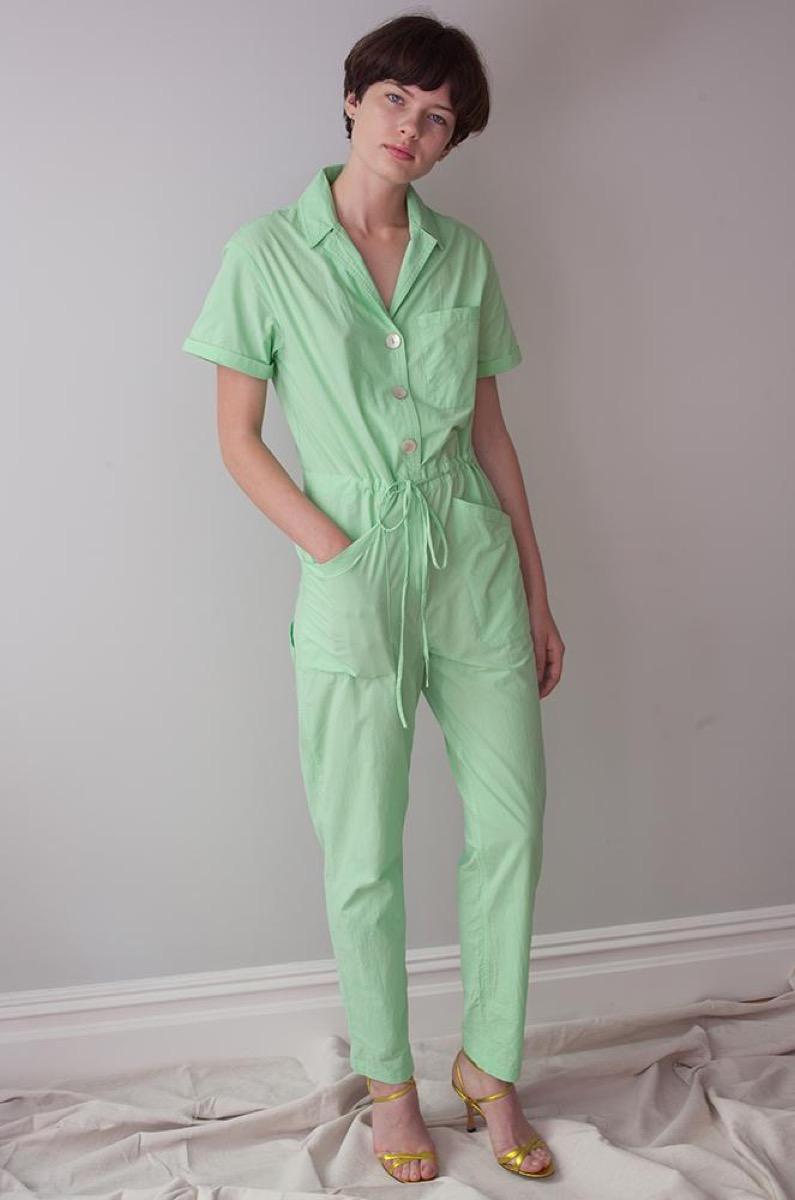 white woman wearing green jumpsuit