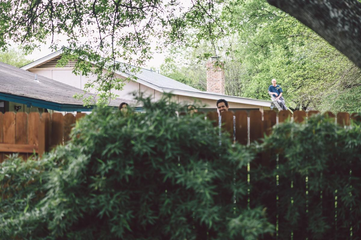 Kaitlin dilworth wedding neighbors looking over fence