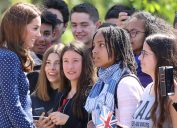 Kate Middleton, Duchess of Cambridge seen meeting schoolchildren as she arrives to visit the D-Day exhibition at Bletchley Park, England in May 2019