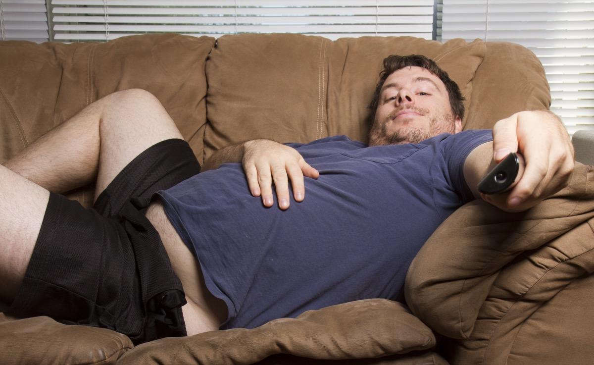 Lazy man watching tv
