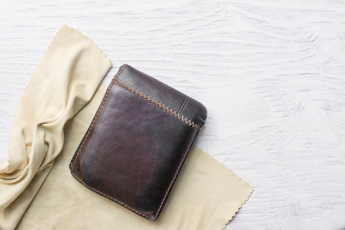 cleaning weather wallet with cloth
