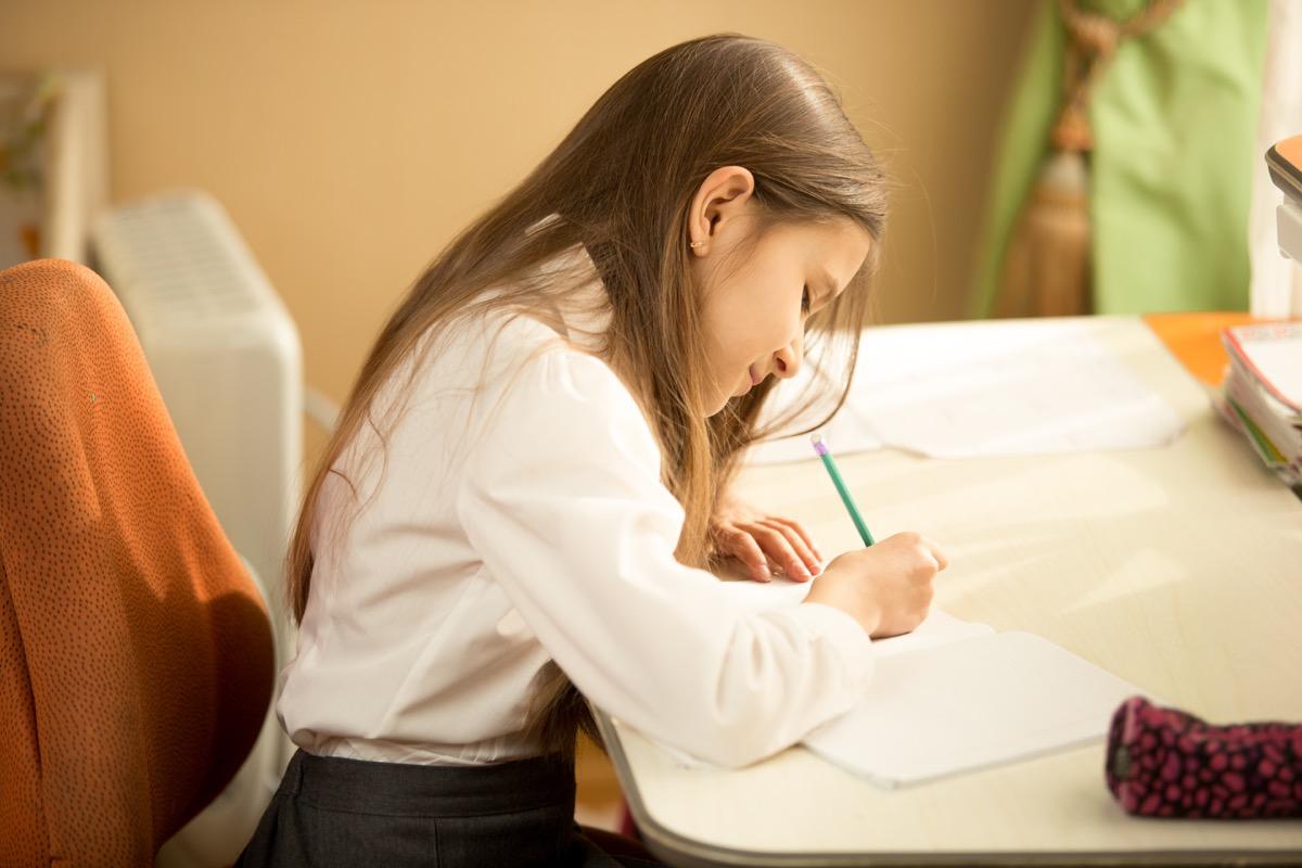 white child writing letter