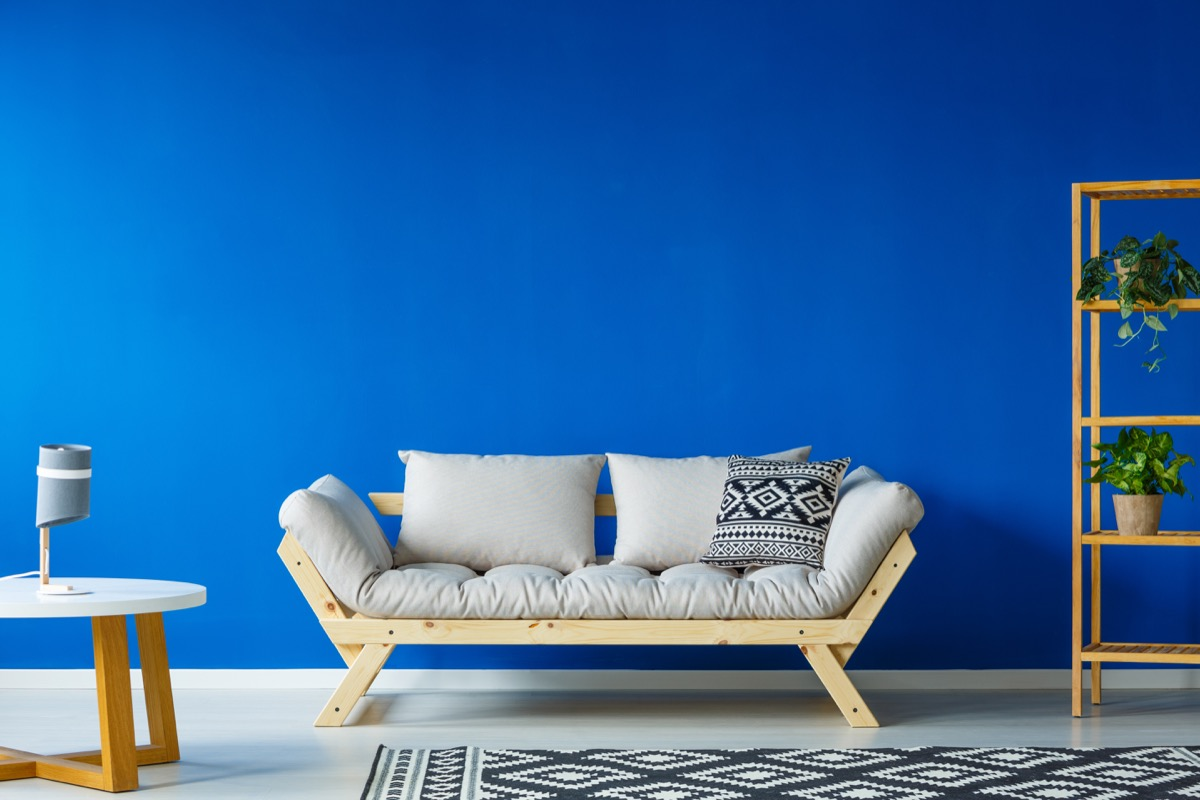 living room with bright blue wall