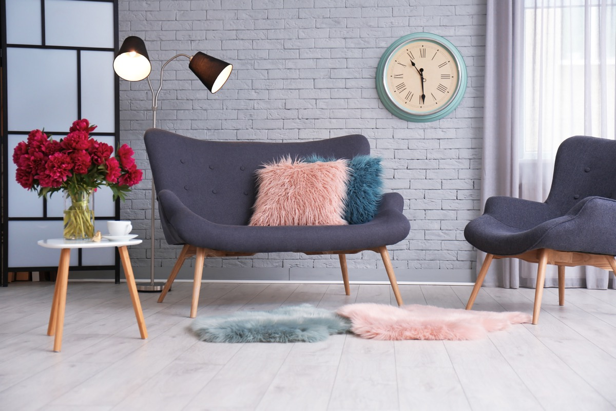 living room with layered shearling rugs