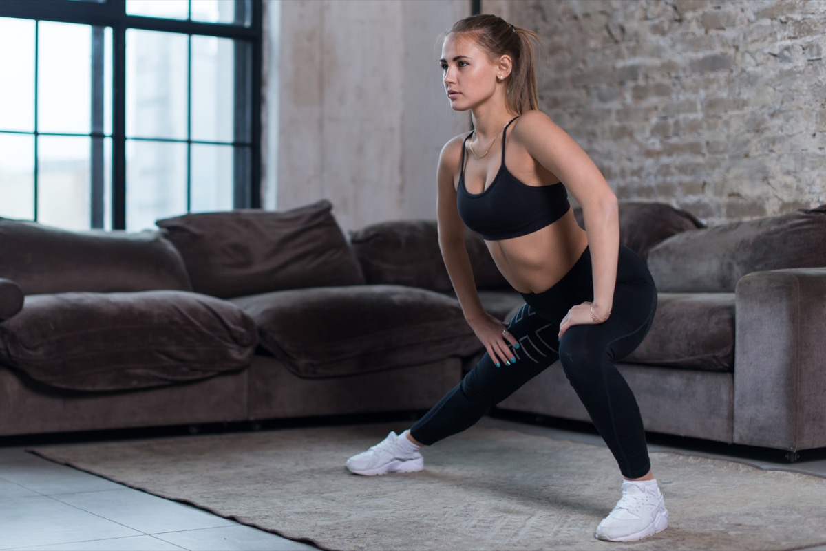 Woman doing lateral lunge