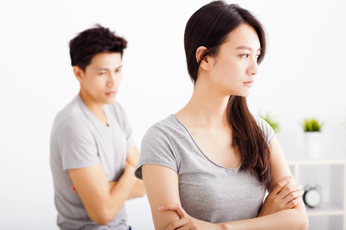 Couple ignoring each other not talking arms crossed