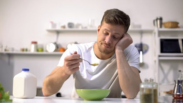 Man without taste eating cereal