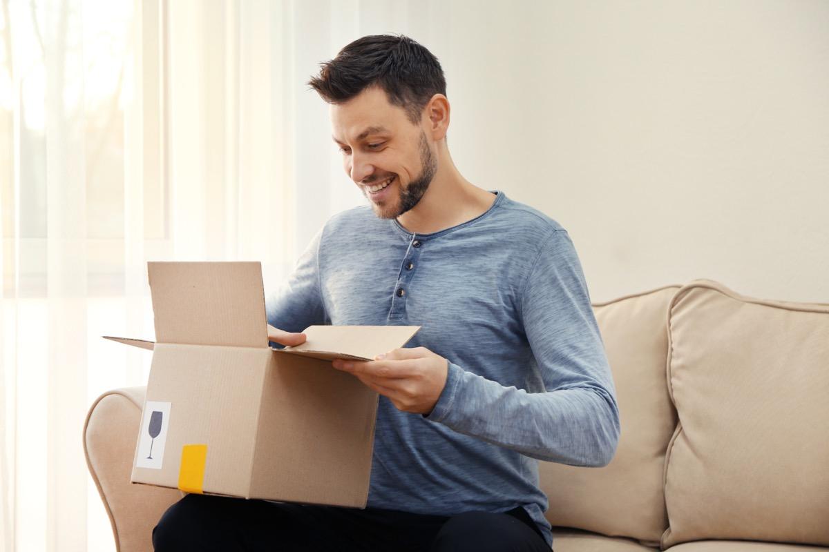 Man opening shipment box