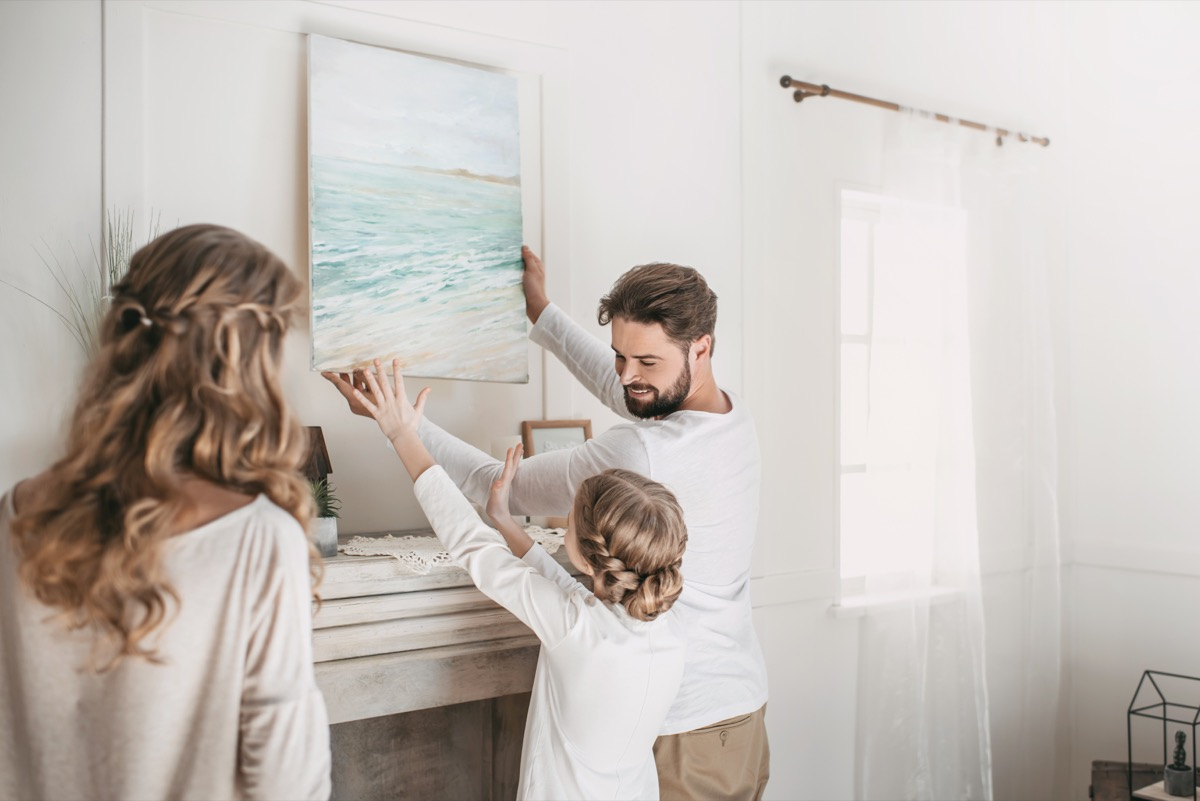 Family hanging picture of beach