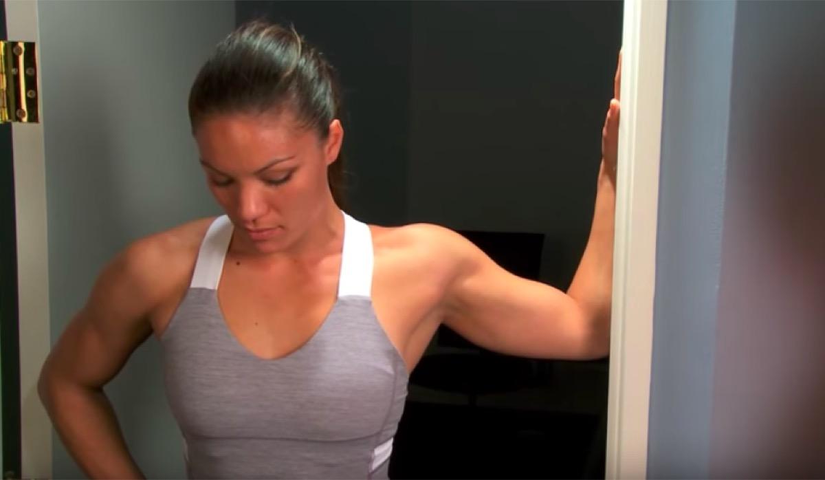 Woman doing pectoralis stretch