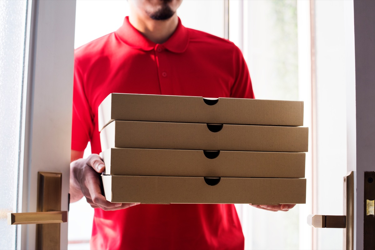 young man delivering pizzas