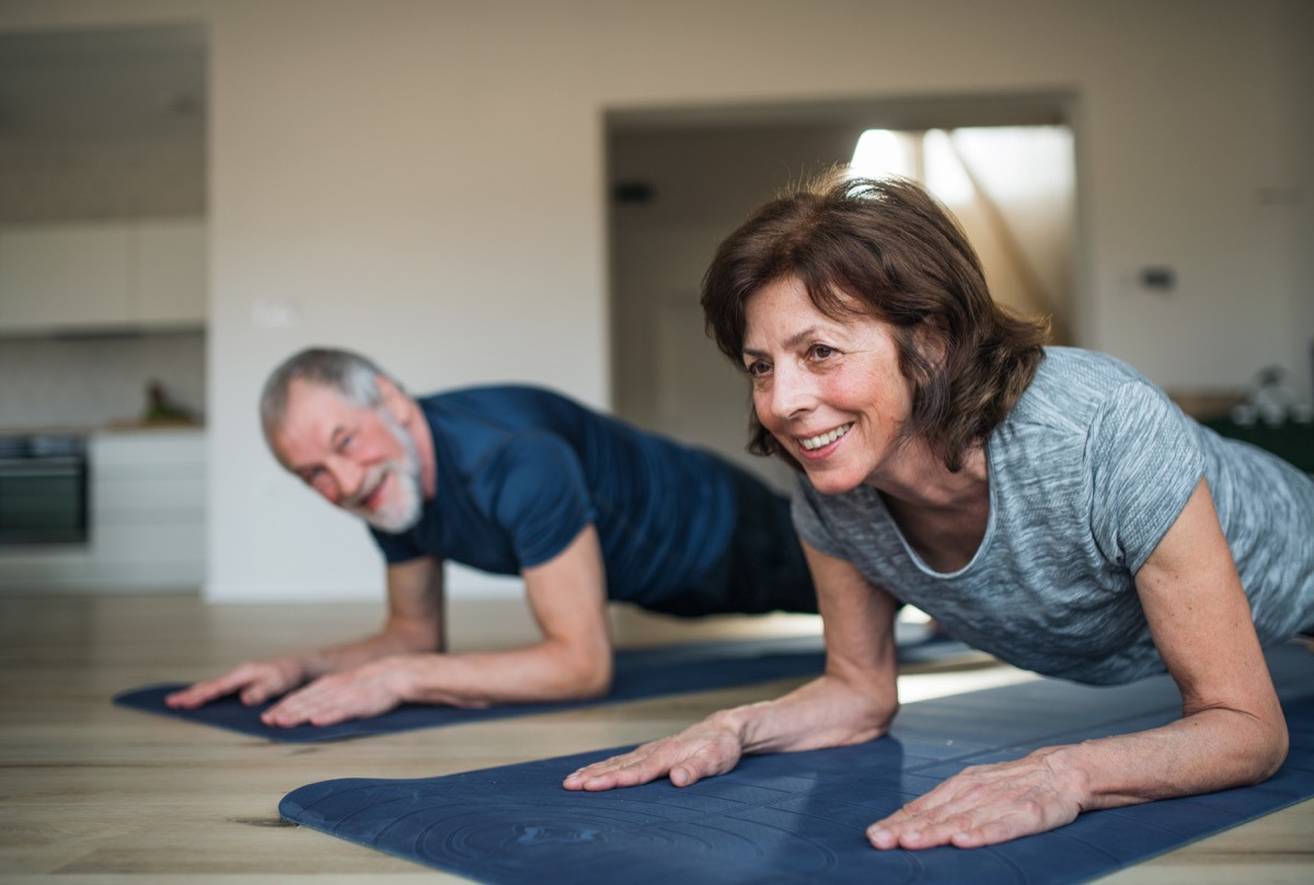 Older couple doing plank walks