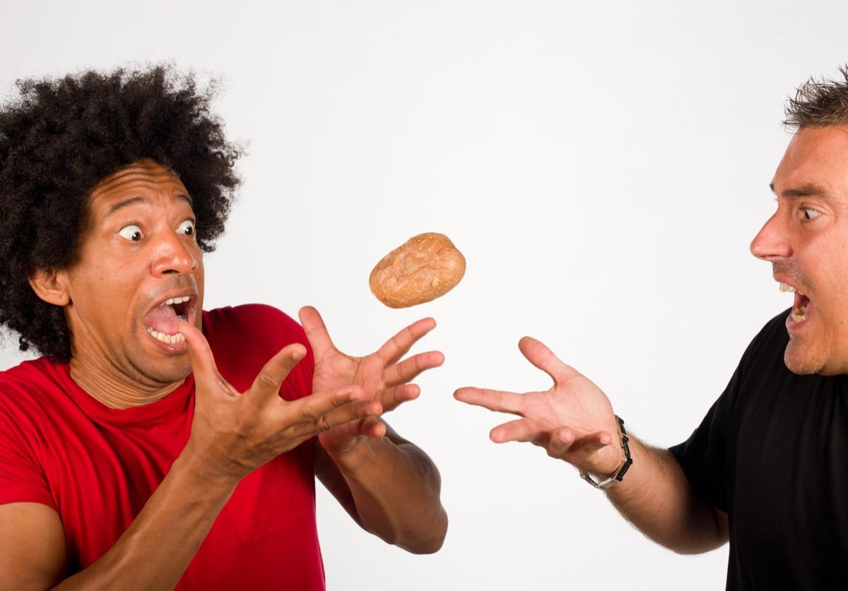 Men playing hot potato