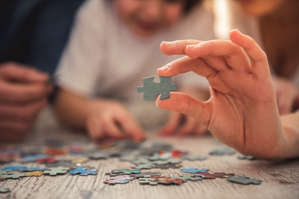 Family doing puzzle together