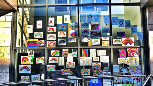 hospital window full of pictures of rainbows