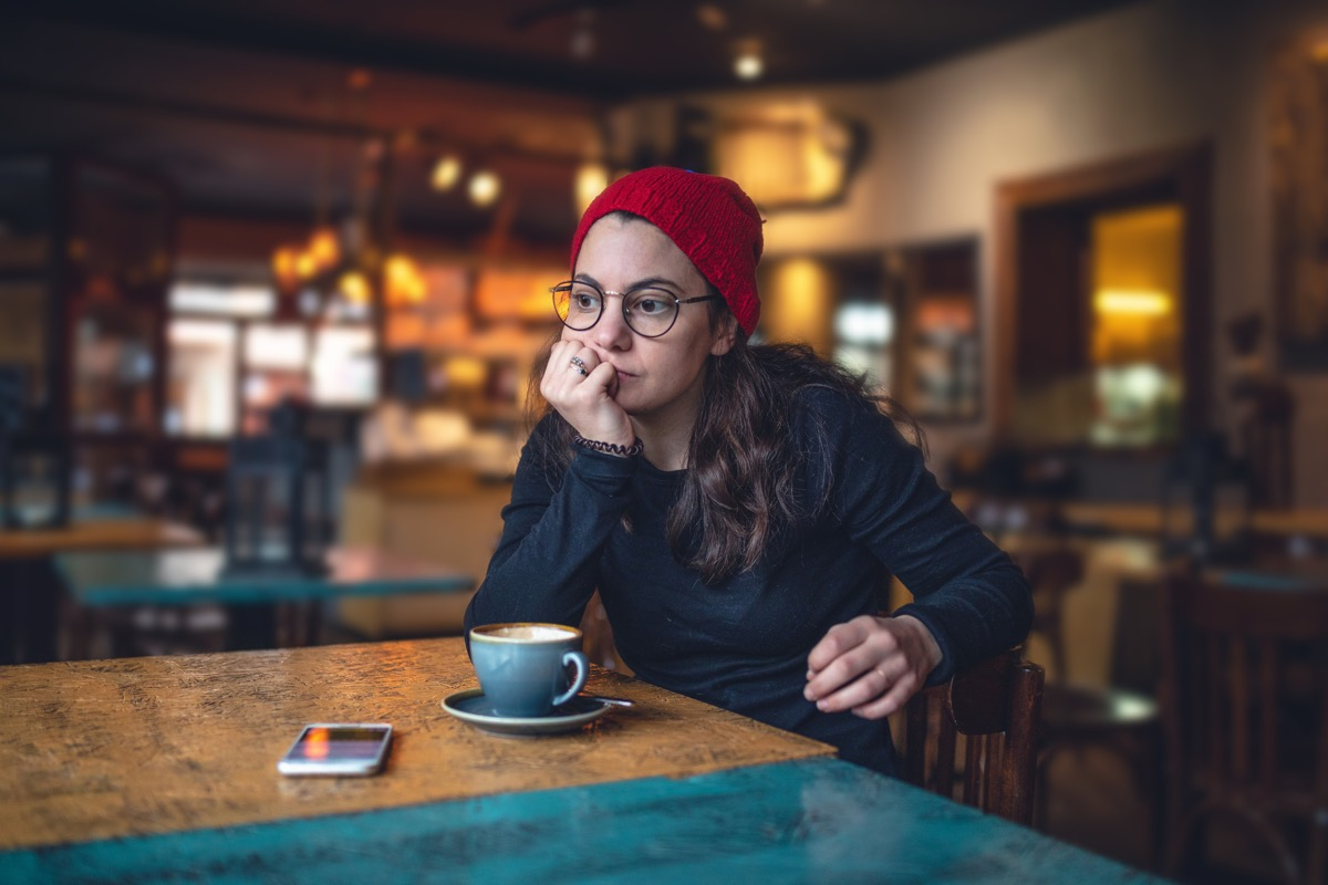 Lovely modern girl enjoying her time at a coffee shop.