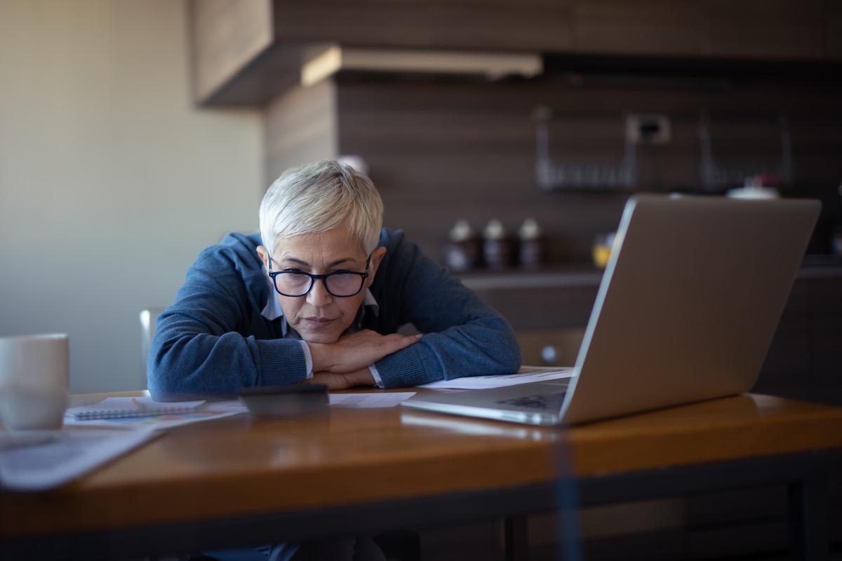 Photo of a senior woman going through financial problems