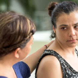 Sad woman being comforted by a friend or sister