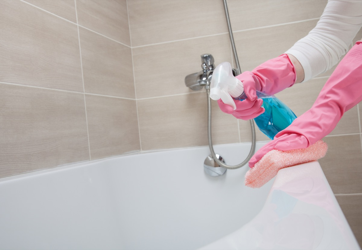 scrubbing tub with gloved hands