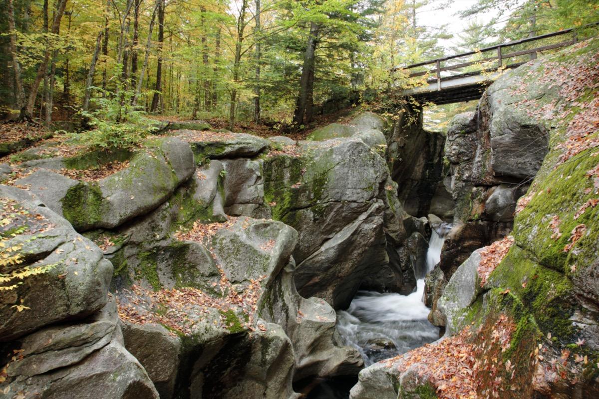 bridge over sculptured rocks and stream in New Hampshire