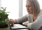 senior woman staring at laptop