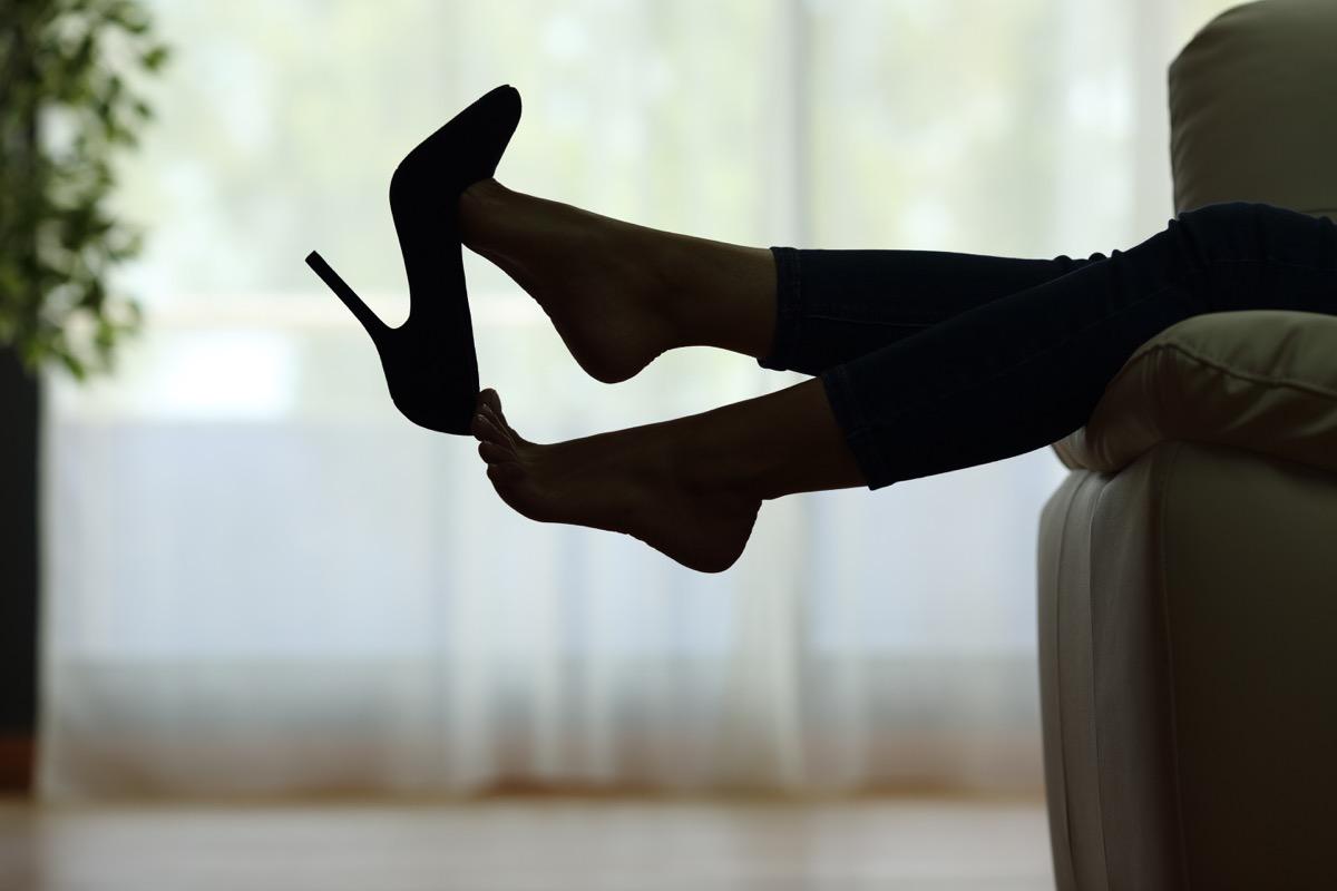 Woman taking heels off