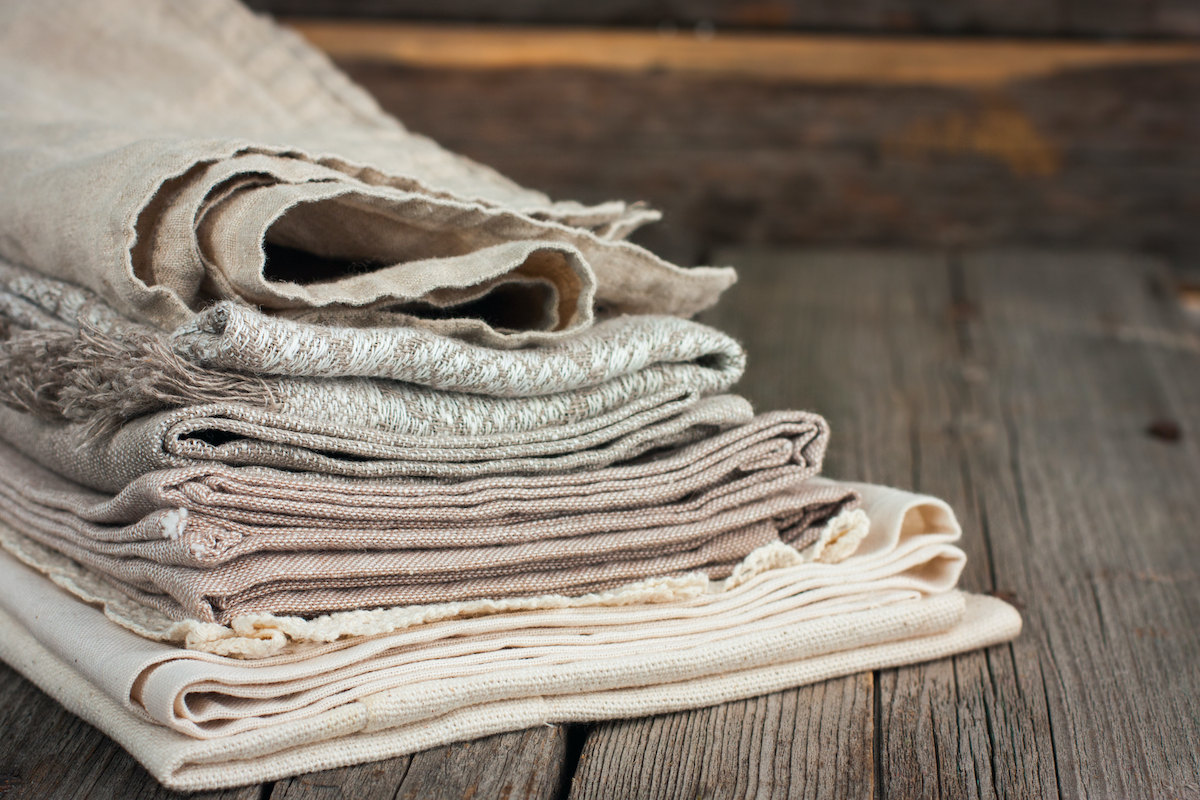pile of linen material on wood boards