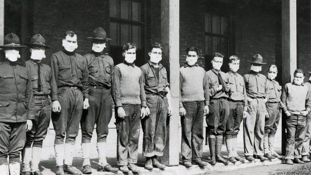 Spanish flu medical men wearing masks outside