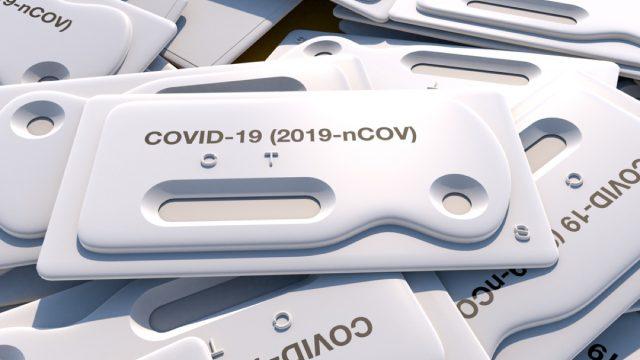 stack of coronavirus tests