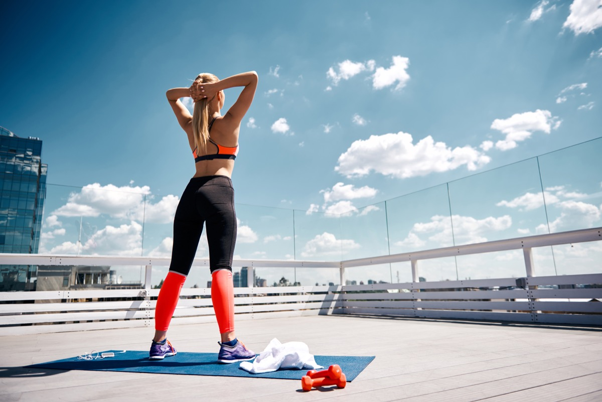 Woman standing working out outside