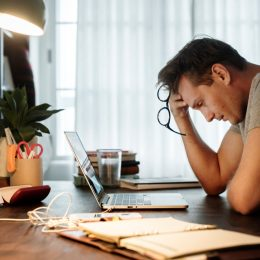 Man stressed working from home